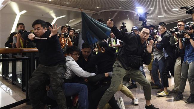 Hong Kong protesters clash with police at shopping malls